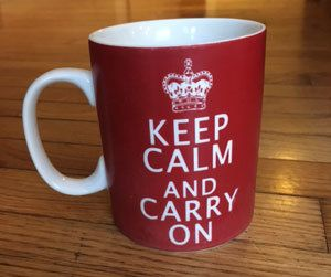 red mug that says keep calm and carry on